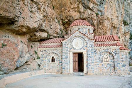 'saint nicholas': greek church of Saint Nicholas the Wonderworker, built under the rock, with an opened door