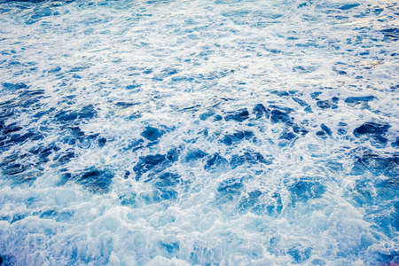 foaming: foaming blue sea background Stock Photo