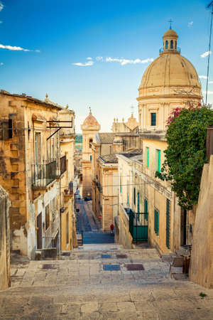 the street leading down at the famous town of Sicily - Noto, the capital of baroque style Stock Photo