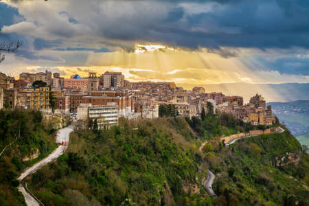 sun breaking through the clouds above the highest city in Sicily - Enna