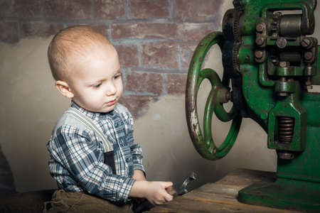 imitating: little boy playing with a spanner imitating a worker