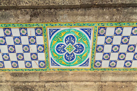 outdoors decorative tile on the wall at Caltagirone, Sicily photo