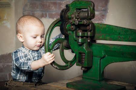 imitating: little boy turning the machine