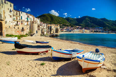 old wooden fishing boats on the beach of Cefalu photo