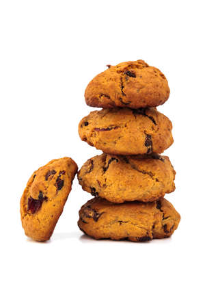 tower of homemade cookies with cranberry, chocolate and raisins, isolated on a white background photo