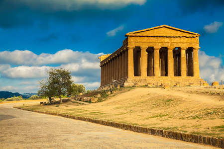 famous Greek ruins of Concordia Temple in the Valley of Temples at the sunset near Agrigento, Sicily