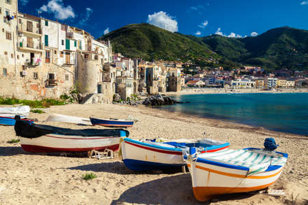 wooden fishing boats on the old beach of Cefalu, Sicily photo
