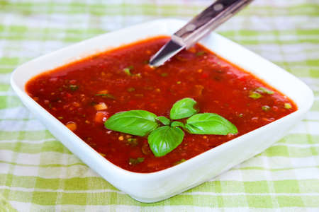 cold soup: spanish cold soup gazpacho with basil Stock Photo