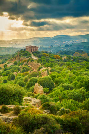 valley of the temples: the sun shining through the clouds at the Valley of Temples near Agrigento, Sicily