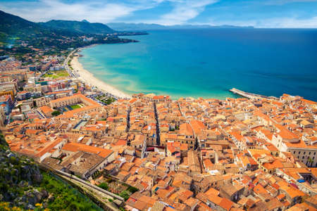 aerial view of Cefalu residential district with old houses near the sea, Sicily, Italy