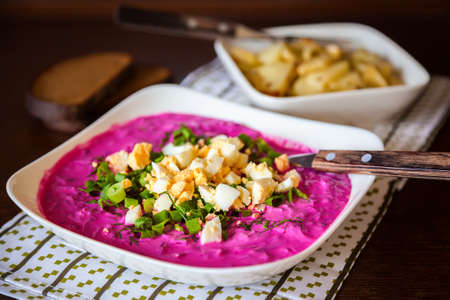 lithuanian: traditional lithuanian cold beetroot soup with greens and eggs, served with hot potatoes