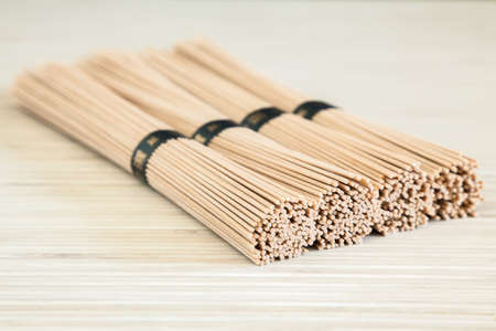 bundles: close-up stacked bundles of buckwheat soba noodles Stock Photo