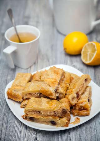 flaky: homemade apple and raisins pie made of flaky pastry Stock Photo