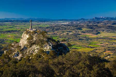 the cross on the hill at the Santuario de San Salvador, Majorca, Spain