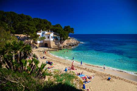 gat: people enjoying the sun on the Cala Gat beach, Majorca, Spain