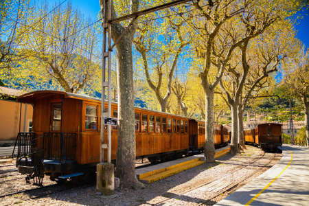 wood railways: famous vintage train stops at the station in Soller, Mallorca, Spain