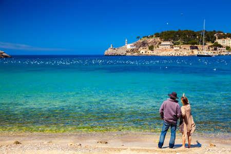 unrecognizable couple enjoying beautiful view of the harbour of Port de Soller, Majorca, Spain
