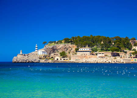 touristic: beautiful landscape with a small lighthouse at the pier of Port de Soller, Majorca, Spain