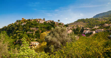 mediterranian houses: small village Deia in the mountains Sierra de Tramuntana, Mallorca, Spain Stock Photo