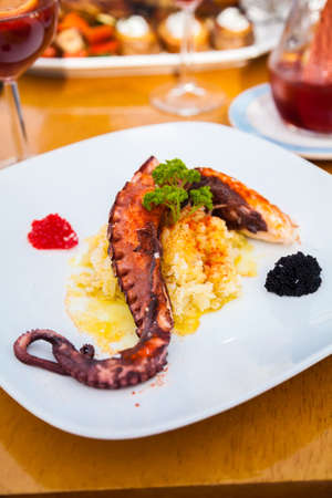 tentacle: grilled octopus tentacle served with mashed potatoes and caviar Stock Photo