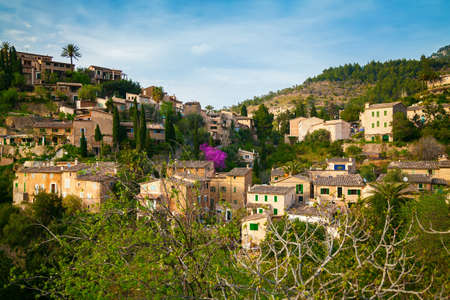 mediterranian houses: beautiful view of small houses in the mountain village Deia in Mallorca, Spain Stock Photo