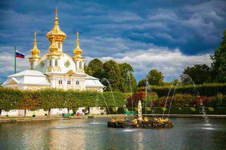 peterhof: eastern square pond with fountain in front of the Palace Church in Peterhof, Russia