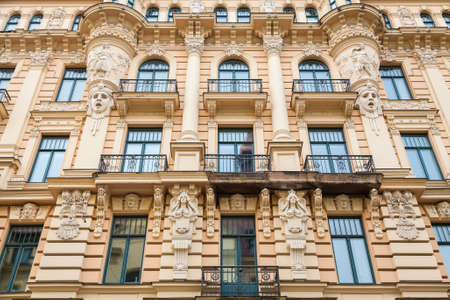 wall decor: beautiful wall with decor, an Art Nouveau architecture style in Riga, Latvia Stock Photo