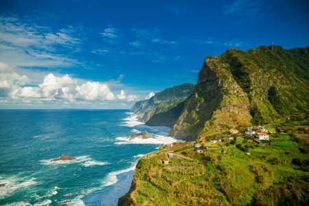 amazing view of mountains and ocean on the northern coast of Madeira near Boaventura