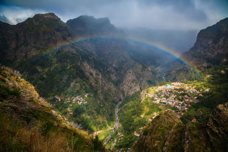 nuns: panoramic view of the rainbow above Nuns Valley, Madeira, Portugal Stock Photo