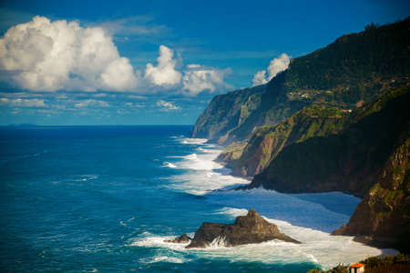 dashing: waves dashing against the cliff on the northern coast of Madeira, Portugal Stock Photo