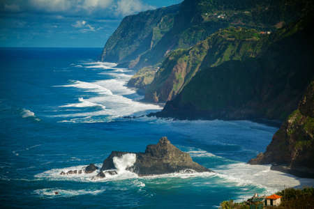 dashing: ocean view of the waves dashing against the cliff on the northern coast of Madeira, Portugal Stock Photo