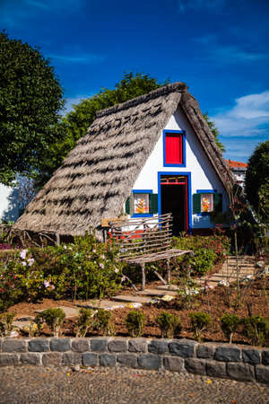 a house with a straw: typical triangular Madeira house, built of wood and thatched with straw
