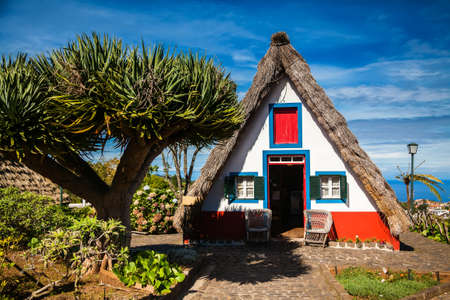 a house with a straw: traditional Madeira house in Santana, built of wood and thatched with straw