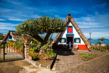 a house with a straw: traditional old Madeira house, built of wood and thatched with straw Stock Photo