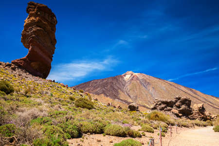 Roque Cinchado is a unique rock formation with famous Pico del Teide mountain volcano in the background, Tenerife, Canary Islands, Spain