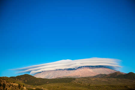 volcano slope: rare view of the mount Teide covered with the cap of clouds, Tenerife, Spain