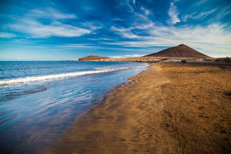 view of Playa el Medano beach with Montana Roja mountain on the background, Tenerife, Canary islands, Spain