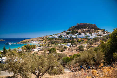 view of the Lindos village and the ancient Acropolis on the hill, Rhodes island, Greece