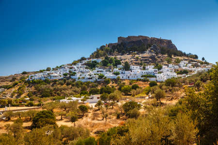 landscape with the ancient Acropolis and white houses in Lindos, Rhodes, Greece