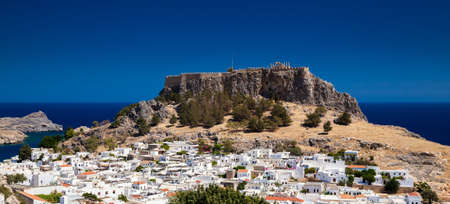 aerial view of the ancient Acropolis and the modern city of Lindos, Rhodes, Greece