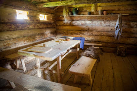 dining room in the ancient wooden peasant hut