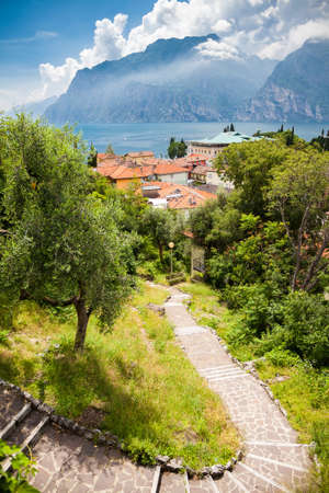 landscape with the stairs leading down to the small village Torbole, Lake Garda, Italy