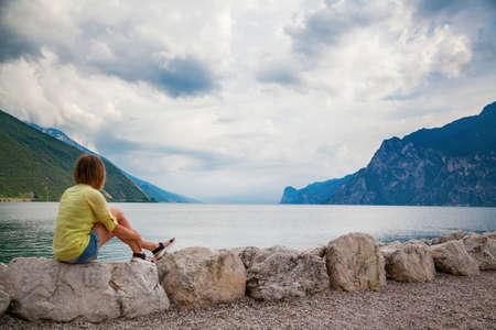 woman looking at the beautiful Garda lake, Italy