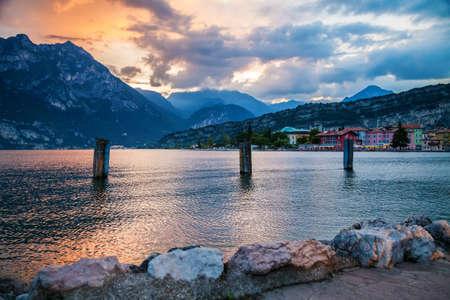 beautiful landscape with sunset at the village Torbole, lake Garda, Italy Archivio Fotografico