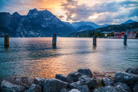 beautiful sunset at the village Torbole on the lake Garda, Italy