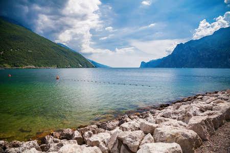 beautiful view of the Garda lake from Torbole beach on a sunny day, Trentino, Italy Archivio Fotografico