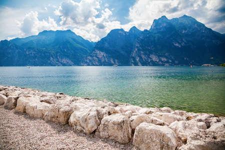 sunny day on a beach of the small village Torbole, Garda lake, Italy