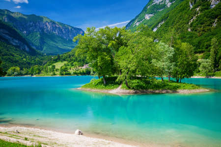 beautiful landscape with the small island in the centre of the mountain lake Tenno, Trentino, Italy Stock Photo