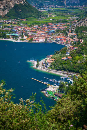 aerial view of a village Nago-Torbole on the north of Garda lake, Italy