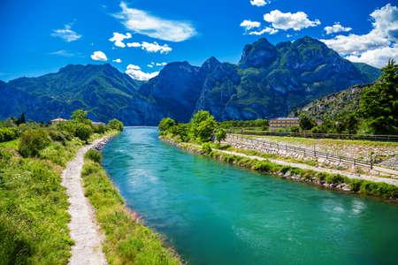 amazing view of the Sarca river in the town Nago-Torbole, lake Garda, Italy Archivio Fotografico